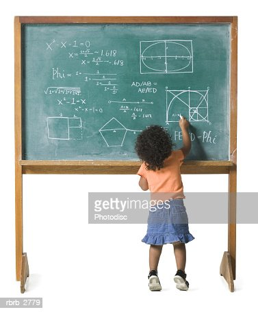 conceptual shot of a young female child as she works out a problem on a chalkboard : Stock Photo