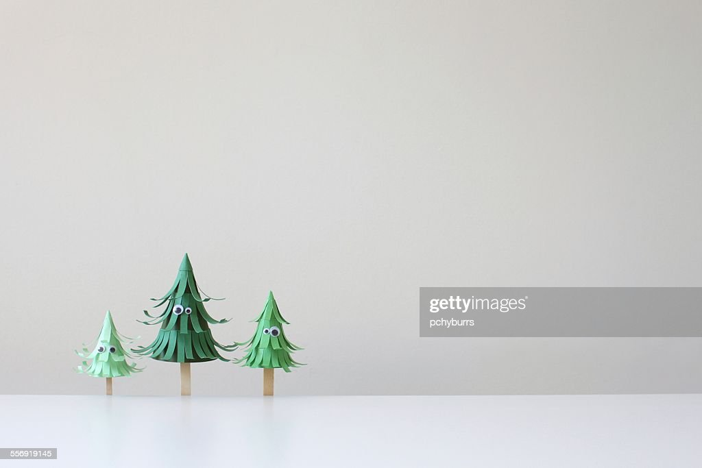 Three paper craft trees with eyes