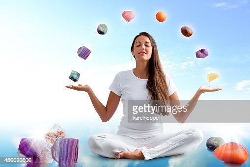 Conceptual yoga with gemstones. : Stock Photo
