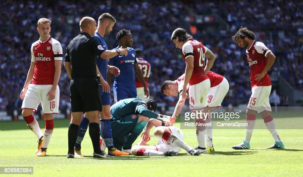 Concern for Arsenal's Per Mertesacker after a clash of heads with Chelsea's Gary Cahill during the FA Community Shield match between Arsenal and...