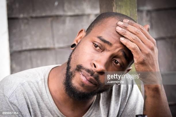 concerned afro caribbean man