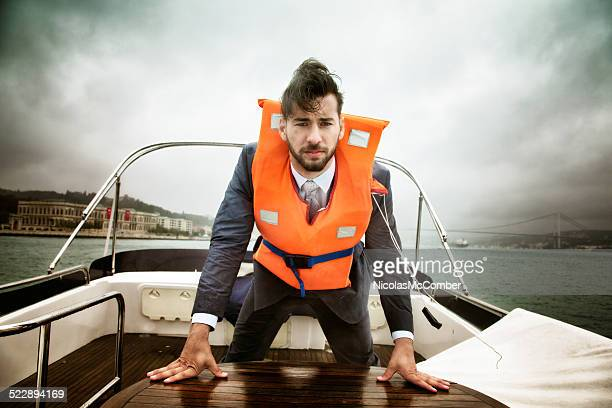 Concerned businessman at sea during a storm looking at camera