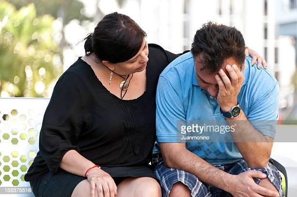 Concerned Hispanic Couple