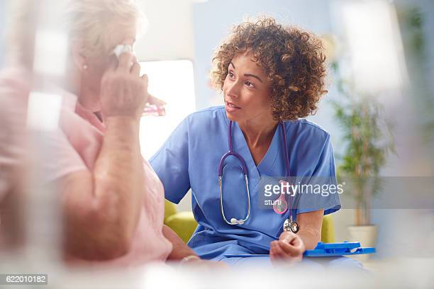 concerned nurse with senior