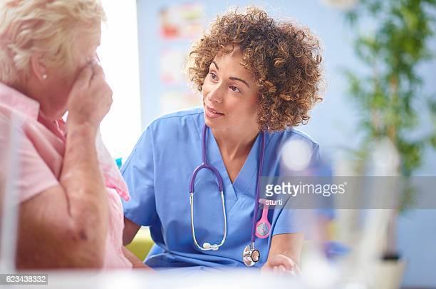 concerned nurse with senior