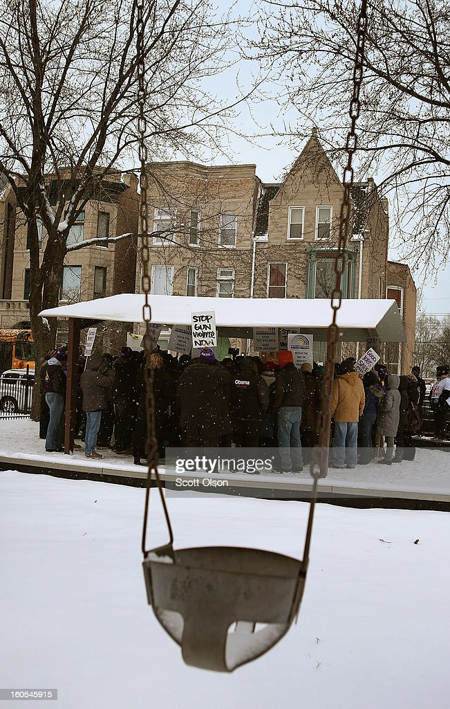 Concerned residents call for an end to gun violence during a march from Dr. Martin Luther King Jr. College Prep High School to nearby Harsh Park February 2, 2013 in Chicago, Illinois. Hadiya Pendleton was a fifteen-year-old honor student at King School who was shot and killed while hanging out with friends on a rainy afternoon under a shelter in Harsh Park on January 29. A $40,000 reward has been raised to help find her killer. Pendleton was the 44th homicide recorded in Chicago for 2013.