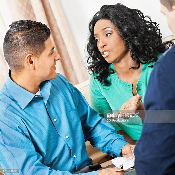 Concerned wife and husband during financial counseling session