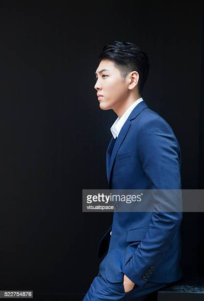 Concerned Young Asian Man in Suit