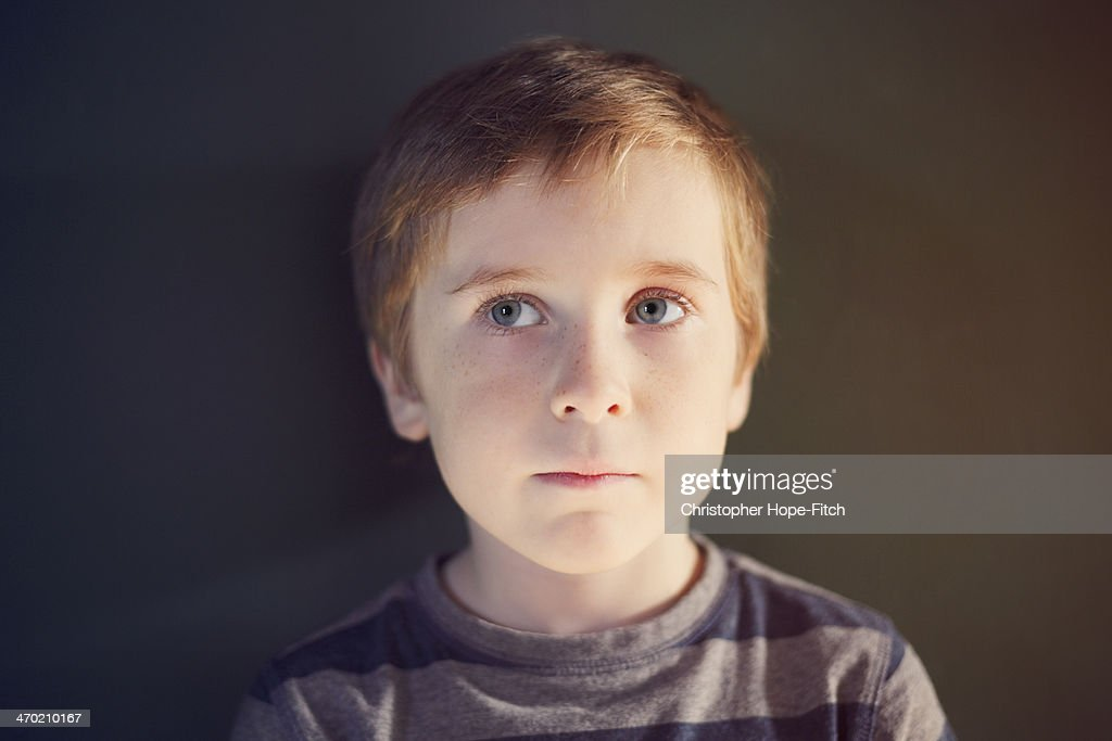 Concerned young boy : Stock Photo