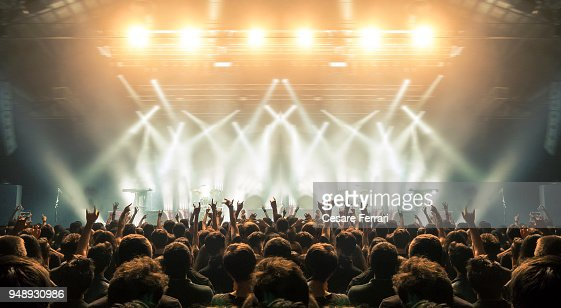Concert arena with fans clapping : Stock Photo