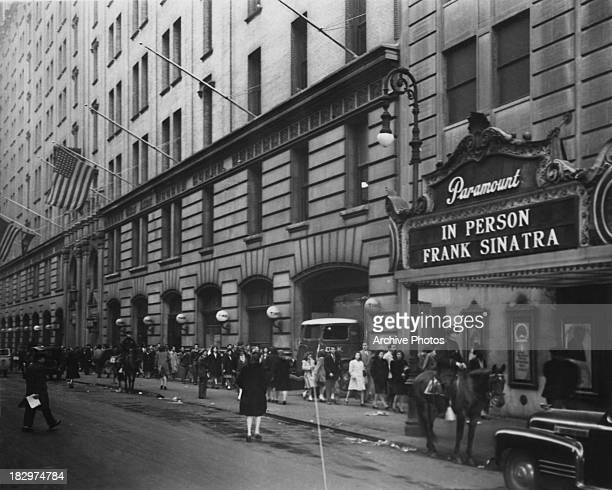 A concert by American actor and singer Frank Sinatra is advertised at the Paramount Theatre New York City 7th November 1945