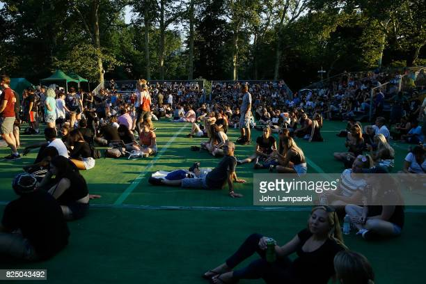 Concert goers are seen during the All Time Low with SWMRS Waterparks and The Wrecks in concert New York New York at Central Park SummerStage on July...