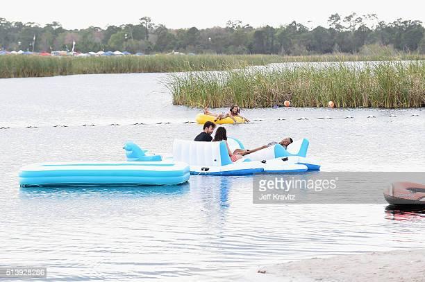 Concert goers enjoy the beac at the Okeechobee Music Arts Festival Day 3 on March 5 2016 in Okeechobee Florida