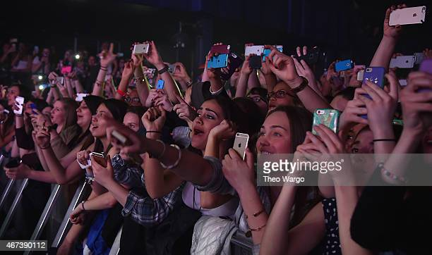 Concert goers use their cellphones during the Fifith Harmony concert at Best Buy Theater on March 23 2015 in New York City