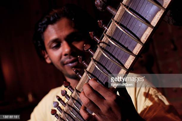 Concert in classical indian music of a Sitar and a tabla player in the Fort Cochin area on November 23 2011 in Cochin Kerala India