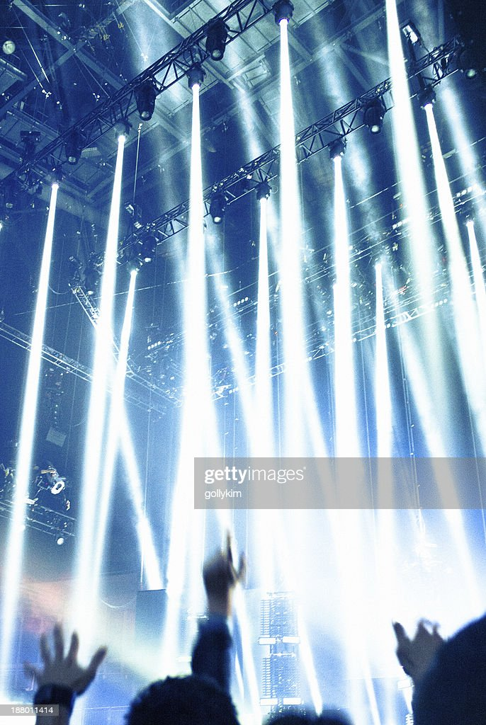 Concert Lighting, arms in the air : Stock Photo