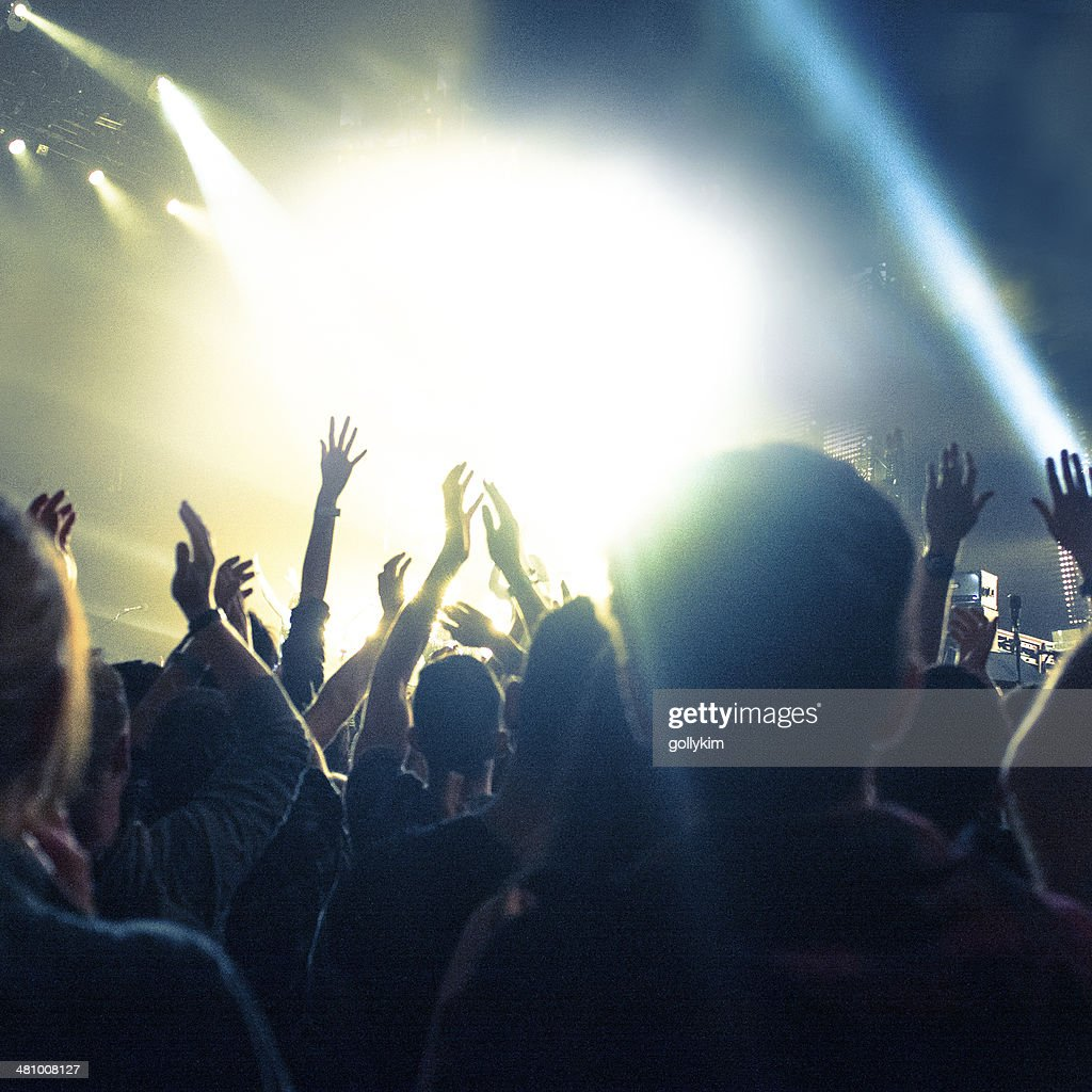 Concert Lighting, arms in the air