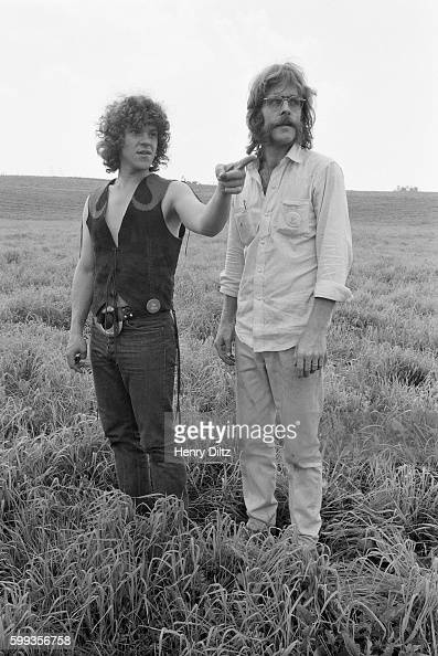 Concert producer Michael Lang speaks with another man before the start of the free Woodstock Music and Art Fair The festival took place on Max...