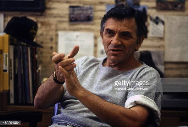 Concert promoter Bill Graham poses for a portrait in his office on April 7 1984 in San Francisco California