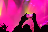 Concert visitor shoots video on a smartphone