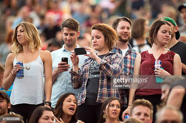 Concertgoers and fans watch as Houndmouth opens for Ryan Adams at Red Rocks Amphitheatre on June 4 in Morrison Colorado
