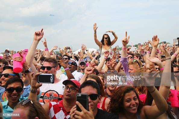 Concertgoers dance to Armen van Buuren in the infield prior to the 140th running of the Preakness Stakes at Pimlico Race Course on May 16 2015 in...