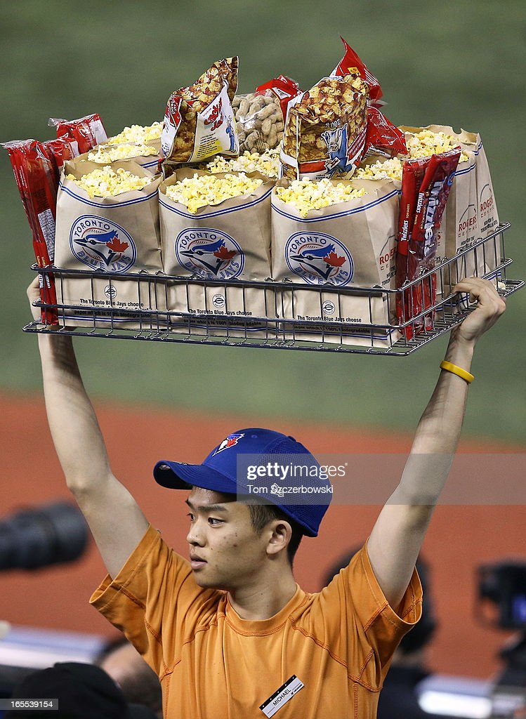 A concessions vendor sells popcorn and peanuts during the Toronto Blue Jays MLB game on Opening Day against the Cleveland Indians on April 2, 2013 at Rogers Centre in Toronto, Ontario, Canada.