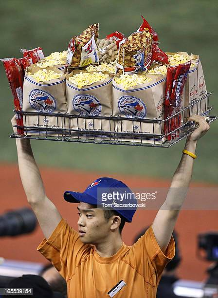 A concessions vendor sells popcorn and peanuts during the Toronto Blue Jays MLB game on Opening Day against the Cleveland Indians on April 2 2013 at...