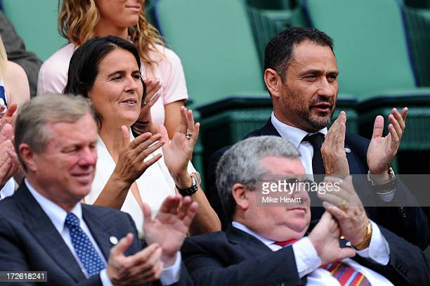 Conchita Martinez and Enrique Tomas watch the Ladies' Singles semi final match between Sabine Lisicki of Germany and Agnieszka Radwanska of Poland on...