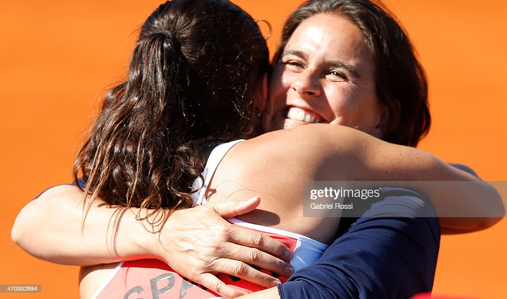 <a gi-track='captionPersonalityLinkClicked' href=/galleries/search?phrase=Conchita+Martinez&family=editorial&specificpeople=184563 ng-click='$event.stopPropagation()'>Conchita Martinez</a> coach of Spain (R) and Lara Arruabarrena of Spain (L) celebrate after winning the round 3 match between Paula Ormaechea of Argentina and Lara Arruabarrena of Spain as part of World Group II Playoffs of Fed Cup 2015 between Argentina and Spain at Tecnopolis on April 19, 2015 in Villa Martelli, Argentina. The playoff will decide who gets to maintain their position in the group.