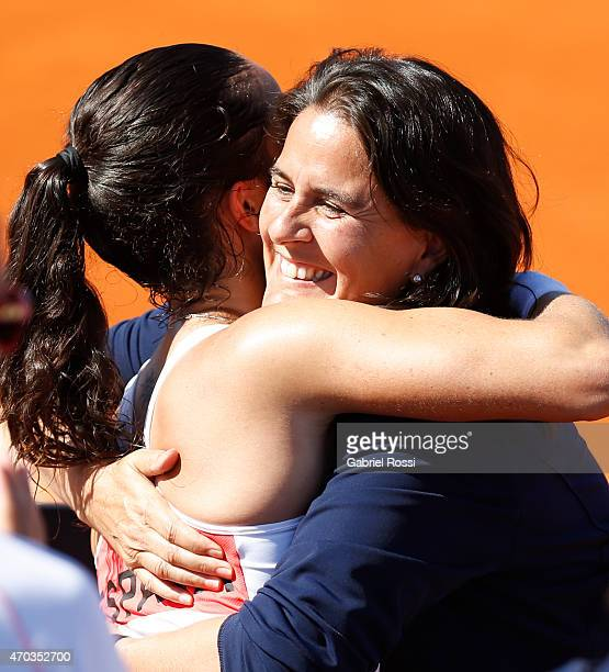 Conchita Martinez coach of Spain and Lara Arruabarrena of Spain celebrate after winning the round 3 match between Paula Ormaechea of Argentina and...