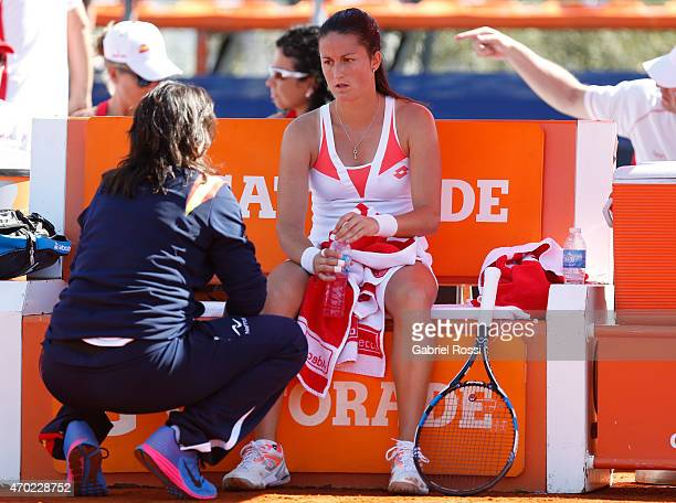 Conchita Martinez coach of Spain talks with Lara Arruabarrena of Spain during a round 2 match between Maria Irigoyen of Argentina and Lara...