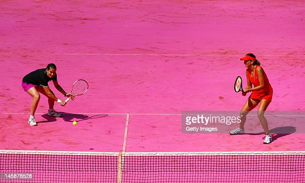 Conchita Martinez of Spain plays a backhand next to her partner Iva Majoli of Croatia during their women's Legends doubles match against Anke Huber...