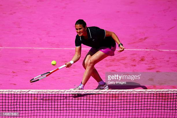 Conchita Martinez of Spain plays a forehand during the women's Legends doubles match between Iva Majoli of Croatia and her partner Conchita Martinez...