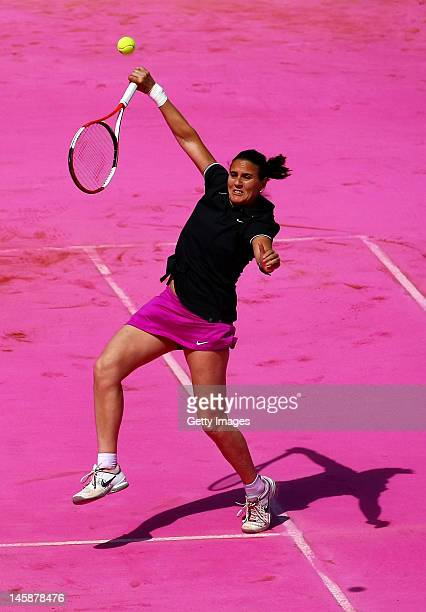 Conchita Martinez of Spain plays a forehand smash during the women's Legends doubles match between Iva Majoli of Croatia and her partner Conchita...
