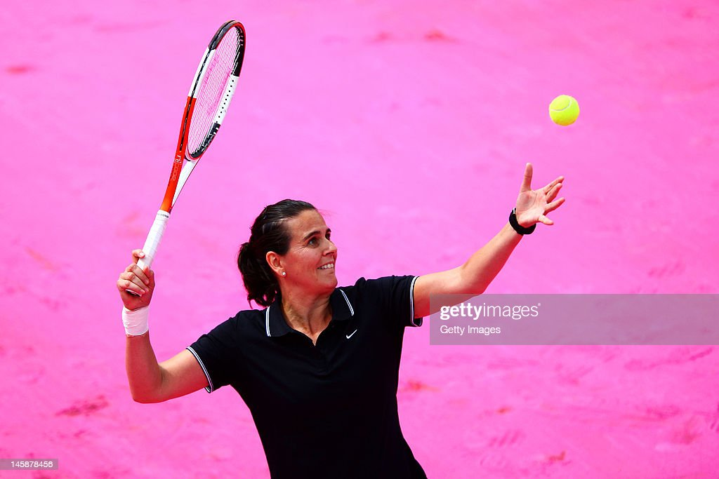 <a gi-track='captionPersonalityLinkClicked' href=/galleries/search?phrase=Conchita+Martinez&family=editorial&specificpeople=184563 ng-click='$event.stopPropagation()'>Conchita Martinez</a> of Spain serves during the women's Legends doubles match between Iva Majoli of Croatia and her partner <a gi-track='captionPersonalityLinkClicked' href=/galleries/search?phrase=Conchita+Martinez&family=editorial&specificpeople=184563 ng-click='$event.stopPropagation()'>Conchita Martinez</a> of Spain and Anke Huber of Germany and her partner Barbara Schett of Austria during day 12 of the French Open at Roland Garros on June 7, 2012 in Paris, France.
