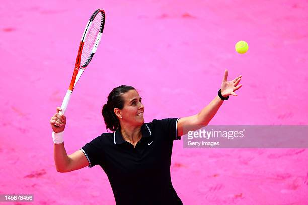 Conchita Martinez of Spain serves during the women's Legends doubles match between Iva Majoli of Croatia and her partner Conchita Martinez of Spain...