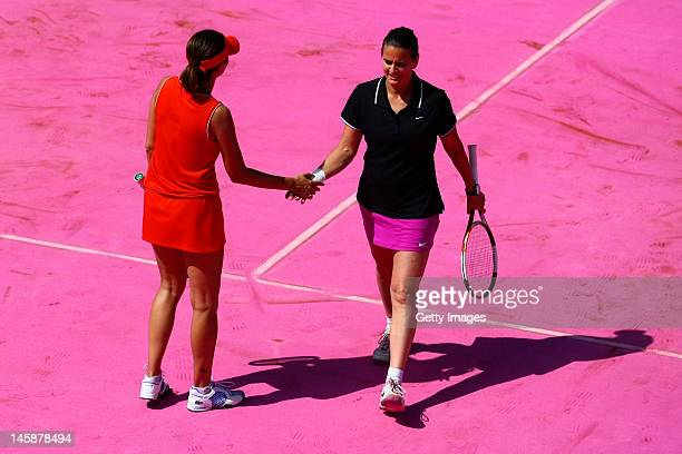 Conchita Martinez of Spain slaps hands with her partner Iva Majoli of Croatia during their women's Legends doubles match against Anke Huber of...