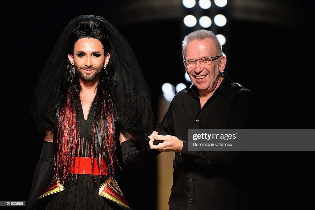 <a gi-track='captionPersonalityLinkClicked' href=/galleries/search?phrase=Conchita+Wurst&family=editorial&specificpeople=9407349 ng-click='$event.stopPropagation()'>Conchita Wurst</a> and Jean Paul Gaultier walk the runway during the Jean Paul Gaultier show as part of Paris Fashion Week - Haute Couture Fall/Winter 2014-2015 at 325 Rue Saint Martin on July 9, 2014 in Paris, France.