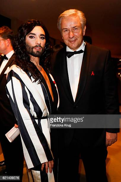 Conchita Wurst and Klaus Wowereit attend the aftershow party during the 23rd Opera Gala at Deutsche Oper Berlin on November 5 2016 in Berlin Germany