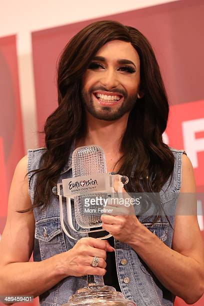 Conchita Wurst arrives for a press conference after winning the Eurovision Song Contest 2014 at the airport on May 11 2014 in Vienna Austria