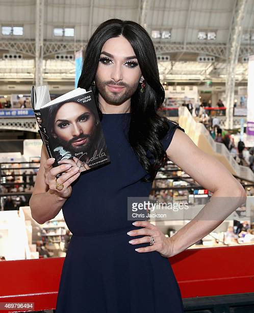 Conchita Wurst attends a photocall during the London Book Fair where she is signing copies of her autobiography 'Being Conchita' at Olympia...