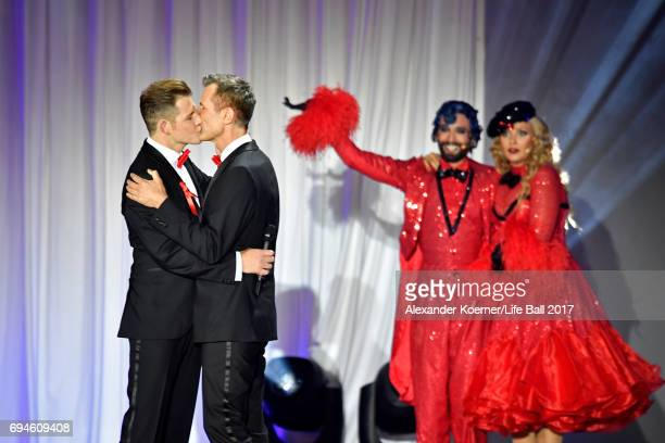 Conchita Wurst cheers during the proposal of a gay couple on stage during the Life Ball 2017 show at City Hall on June 10 2017 in Vienna Austria