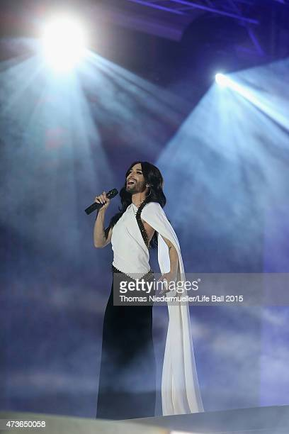 Conchita Wurst performs live on stage during the Life Ball 2015 show at City Hall on May 16 2015 in Vienna Austria