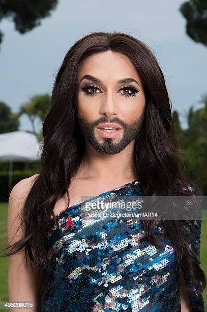 Conchita Wurst poses for a portrait at amfAR's 21st Cinema Against AIDS Gala Presented By WORLDVIEW BOLD FILMS And BVLGARI at Hotel du CapEdenRoc on...