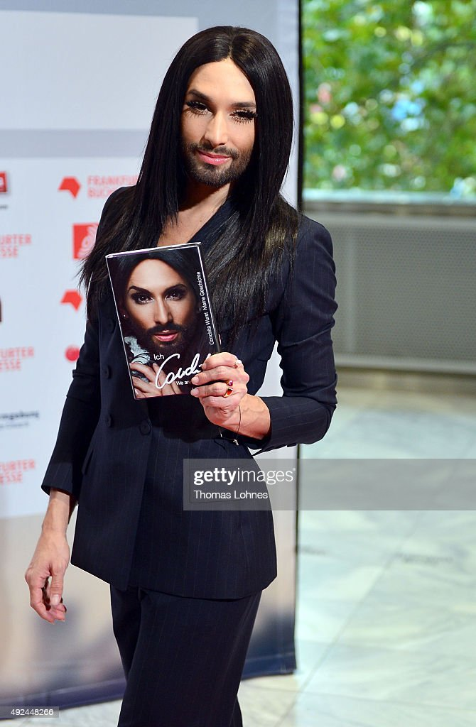 Conchita Wurst poses with his book at the red carpet before the opening ceremony of the 2015 Frankfurt Book Fair (Frankfurter Buchmesse) on October 13, 2015 in Frankfurt am Main, Germany. The fair, which is among the world's largest book fairs, will be open to the public from October 13-18.