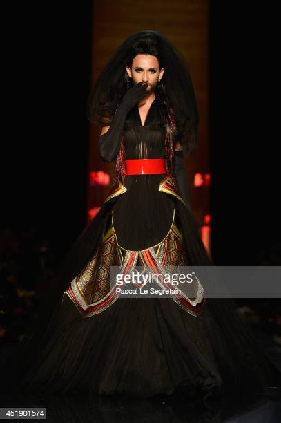 Conchita Wurst walks the runway during the Jean Paul Gaultier show as part of Paris Fashion Week Haute Couture Fall/Winter 20142015 at 325 Rue Saint...