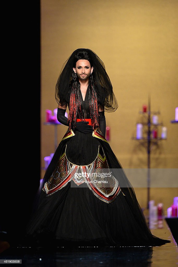 <a gi-track='captionPersonalityLinkClicked' href=/galleries/search?phrase=Conchita+Wurst&family=editorial&specificpeople=9407349 ng-click='$event.stopPropagation()'>Conchita Wurst</a> walks the runway during the Jean Paul Gaultier show as part of Paris Fashion Week - Haute Couture Fall/Winter 2014-2015 at 325 Rue Saint Martin on July 9, 2014 in Paris, France.