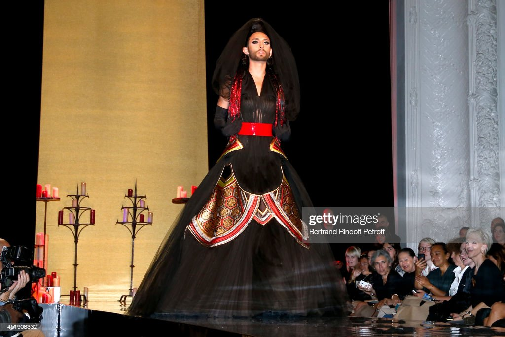 <a gi-track='captionPersonalityLinkClicked' href=/galleries/search?phrase=Conchita+Wurst&family=editorial&specificpeople=9407349 ng-click='$event.stopPropagation()'>Conchita Wurst</a> walks the runway during the Jean Paul Gaultier show as part of Paris Fashion Week - Haute Couture Fall/Winter 2014-2015. Held at 325 Rue Saint Martin on July 9, 2014 in Paris, France.