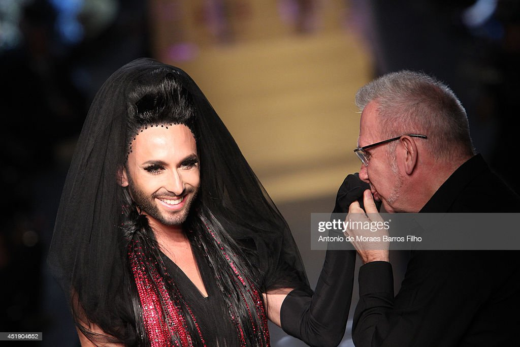 <a gi-track='captionPersonalityLinkClicked' href=/galleries/search?phrase=Conchita+Wurst&family=editorial&specificpeople=9407349 ng-click='$event.stopPropagation()'>Conchita Wurst</a>,Jean Paul Gaultier walk the runway during the Jean Paul Gaultier show as part of Paris Fashion Week - Haute Couture Fall/Winter 2014-2015 at 325 Rue Saint Martin on July 9, 2014 in Paris, France.